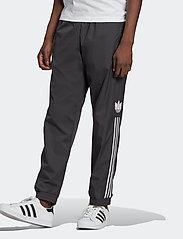 adidas Originals - Adicolor 3D Trefoil 3-Stripes Track Pants - treenihousut - black - 0