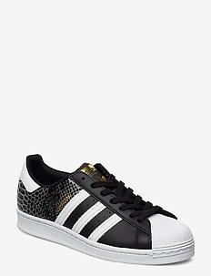 SUPERSTAR W - låga sneakers - cblack/ftwwht/goldmt