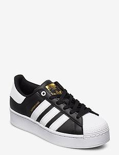 Superstar Bold W - lage sneakers - cblack/ftwwht/goldmt