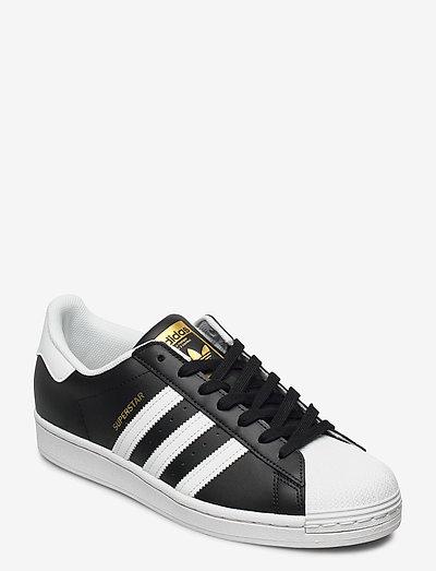 Superstar - låga sneakers - cblack/ftwwht/goldmt