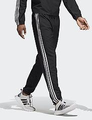 adidas Performance - Essentials 3-Stripes Wind Pants - treenihousut - black/white - 0