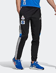 adidas Performance - Own The Run Space Race Track Pants - treenihousut - black - 0
