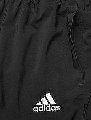 adidas Performance - AEROREADY Essentials Stanford Tapered Logo Pants - spodnie treningowe - black - 4
