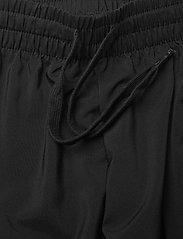 adidas Performance - AEROREADY Essentials Stanford Tapered Logo Pants - spodnie treningowe - black - 5