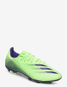 X GHOSTED.3 FG - football shoes - siggnr/eneink/siggnr