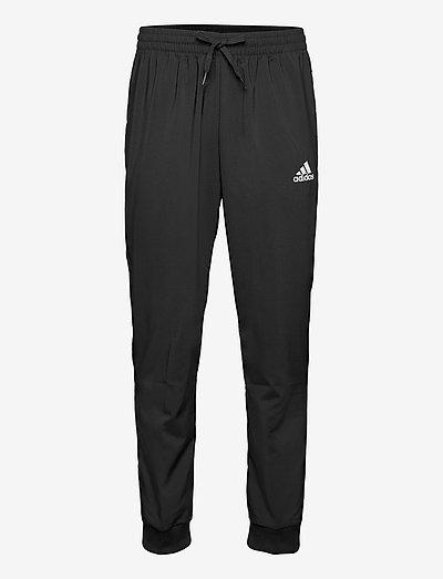 AEROREADY Essentials Stanford Tapered Logo Pants - träningsbyxor - black