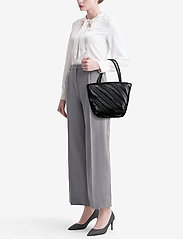 Alexander Wang - ROXY SOFT SMALL TOTE BLACK LOGO QUILTED NYLON - fashion shoppers - black - 1