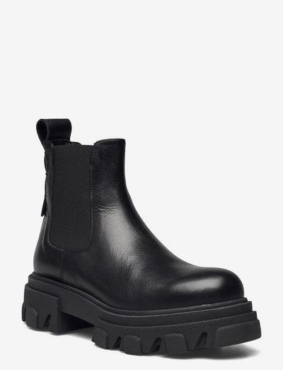 Mega chuncky elastic short - chelsea boots - nero