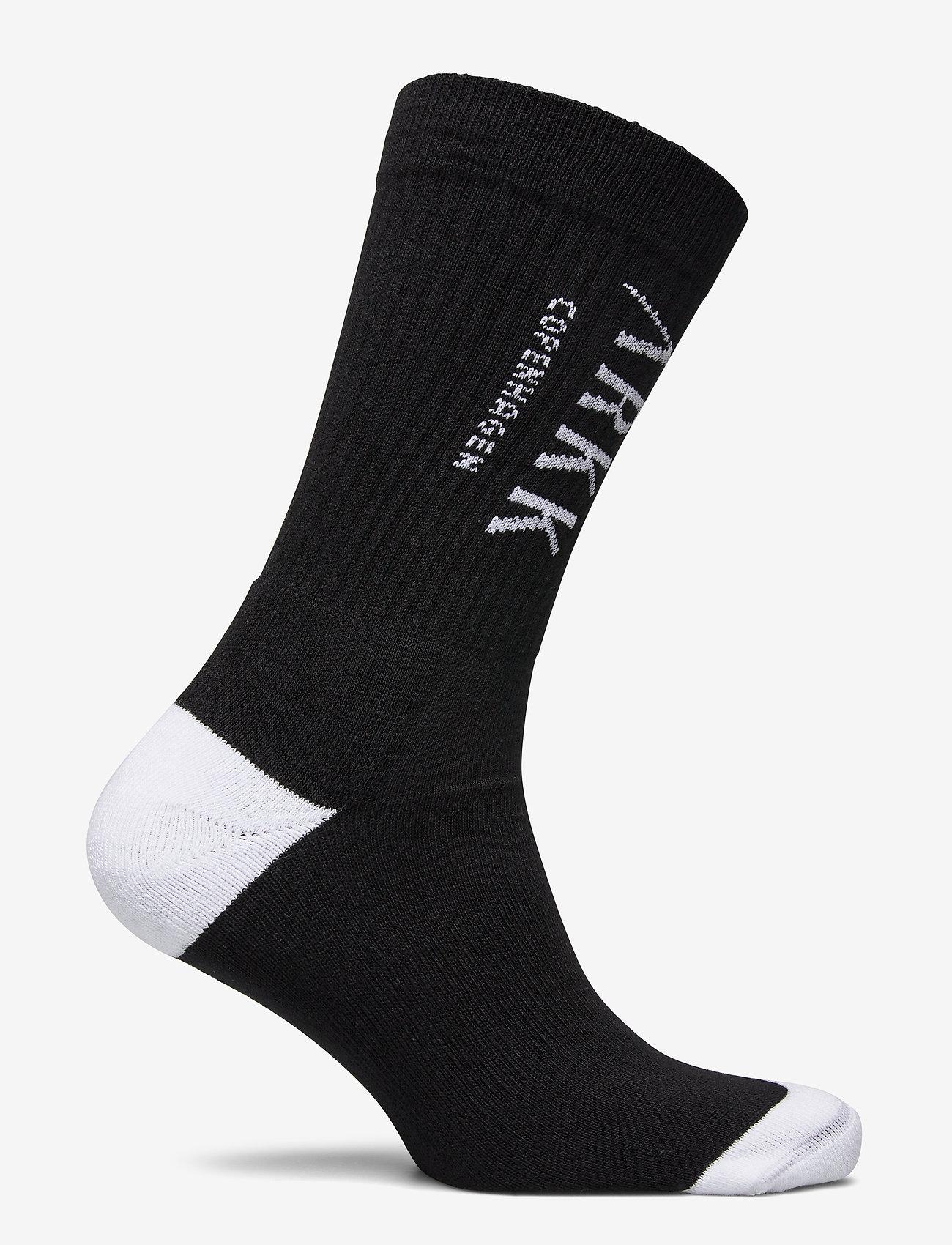 Arkk Copenhagen The High Sock - Essential Black Whi Strømper White