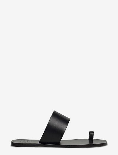 Astrid Black Vacchetta - flat sandals - black
