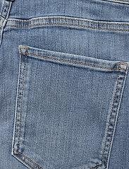 Banana Republic - High-Rise Skinny Button-Fly Jean - slim jeans - medium wash - 4