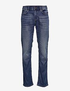 Slim LUXE Traveler Dark Wash Jean - WASHED INDIGO