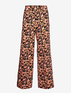 NATIA - wide leg trousers - peachblack floral