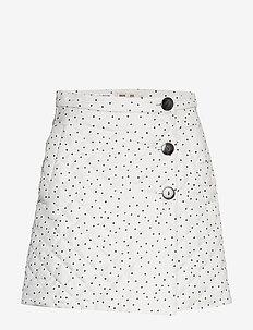 SHERIDAN - short skirts - creamblack flying dots