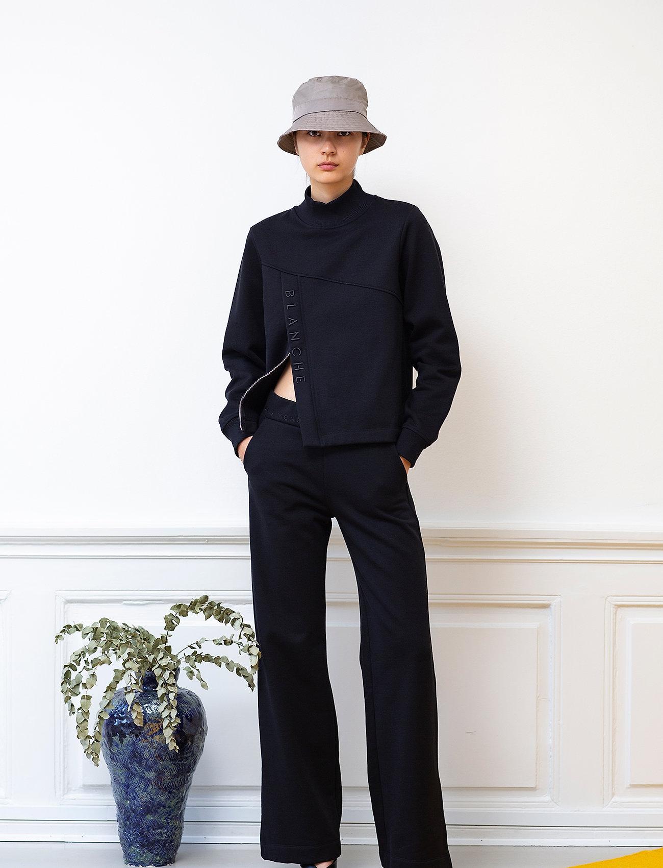 Blanche - Hella Slit Pants - bukser med brede ben - black - 0