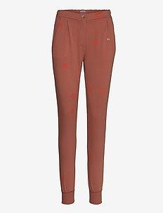 Printed fleece pants - spodnie dresowe - mahogany
