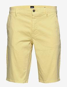Schino-Slim Shorts - chinos shorts - light/pastel yellow