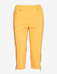 Capri pants - slim fit housut - yolk yellow