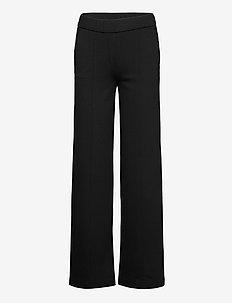 Casual pants - uitlopende broeken - black