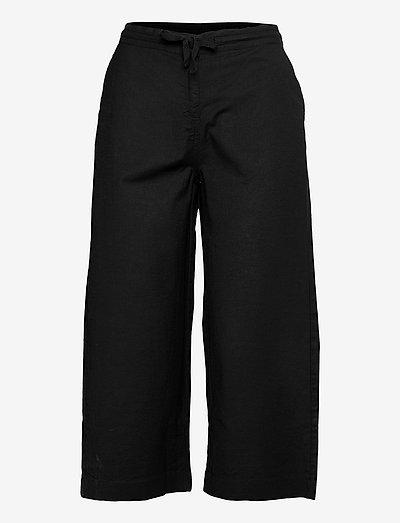 Capri pants - bukser med brede ben - black