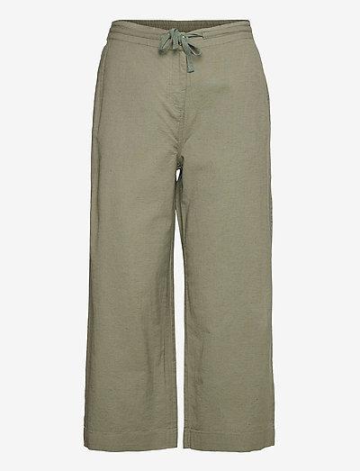 Capri pants - bukser med brede ben - deep lichen green