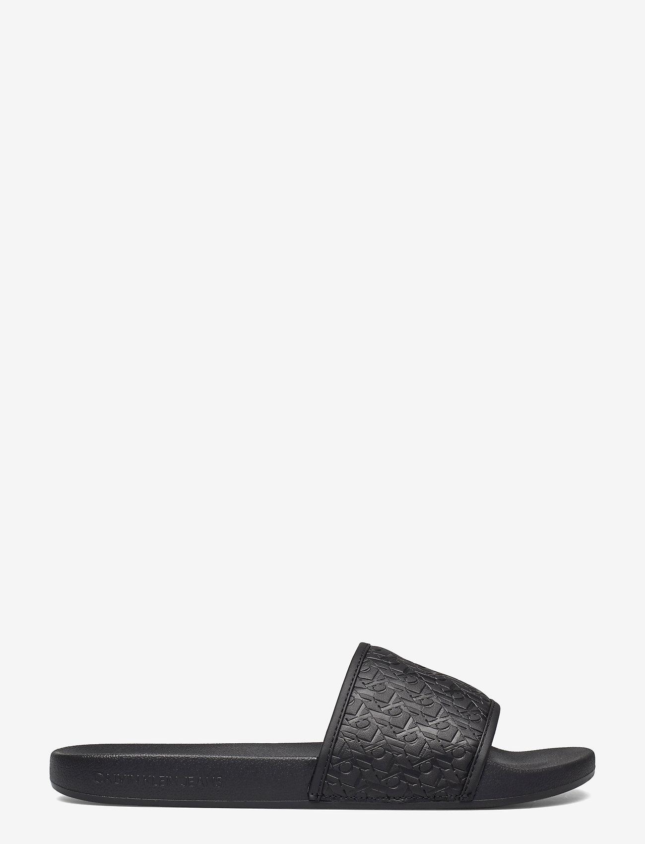 Calvin Klein - SLIDE AOP EMBOSSED PES-PU-CO - pool sliders - black - 1