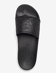 Calvin Klein - SLIDE AOP EMBOSSED PES-PU-CO - pool sliders - black - 3
