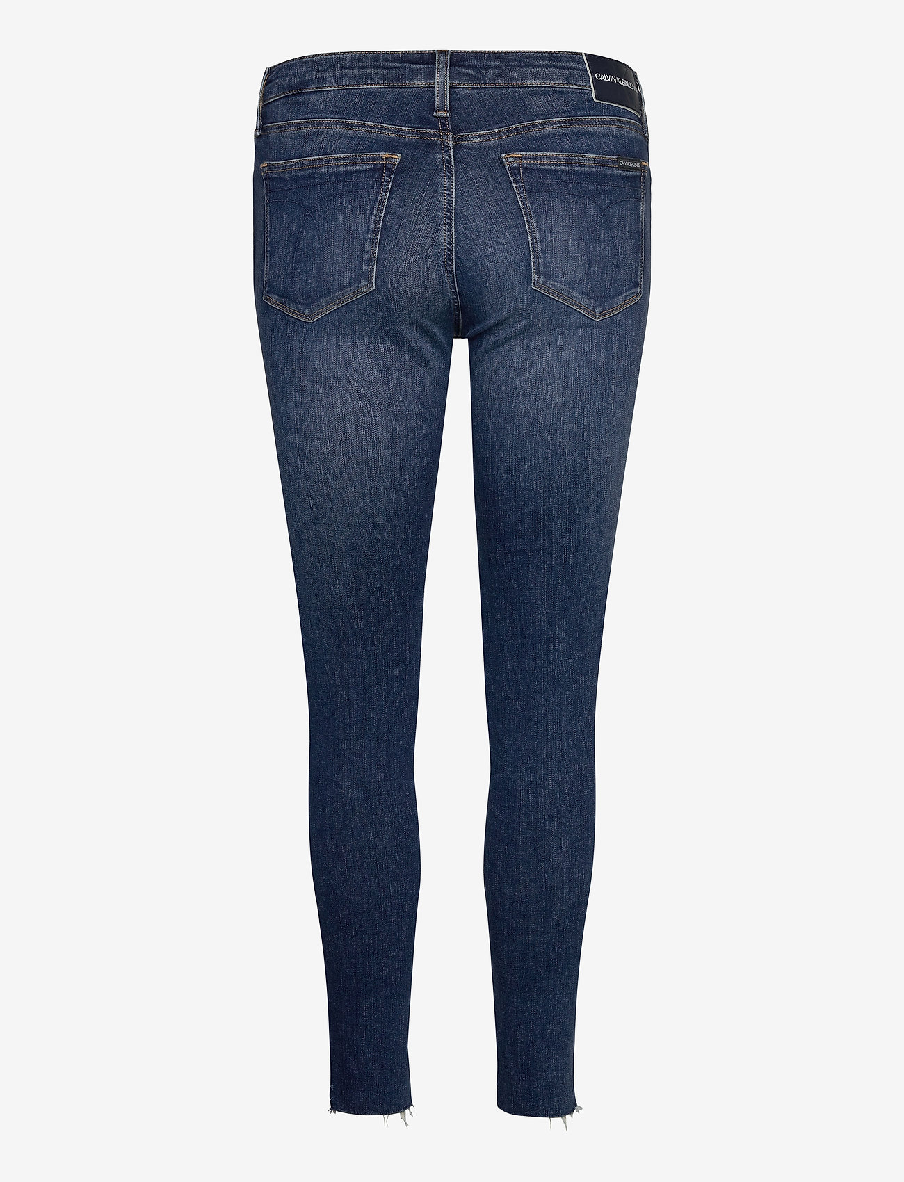 Calvin Klein Jeans CKJ 011 MID RISE SKINNY ANKLE - Dżinsy AB115 DARK BLUE EMBRO RWH - Kobiety Odzież.