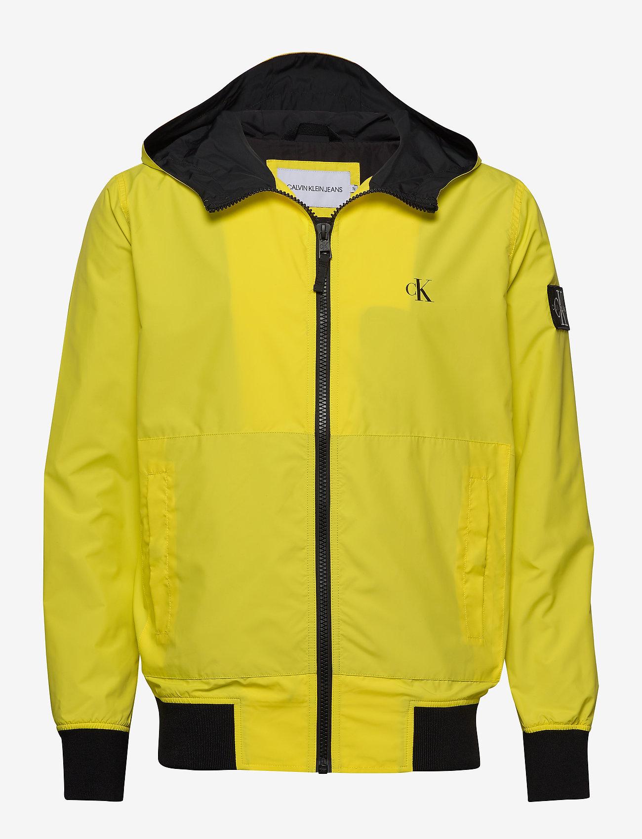 Calvin Klein Jeans - HOODED BLOCKING NYLON JACKET - light jackets - solar yellow/black - 0