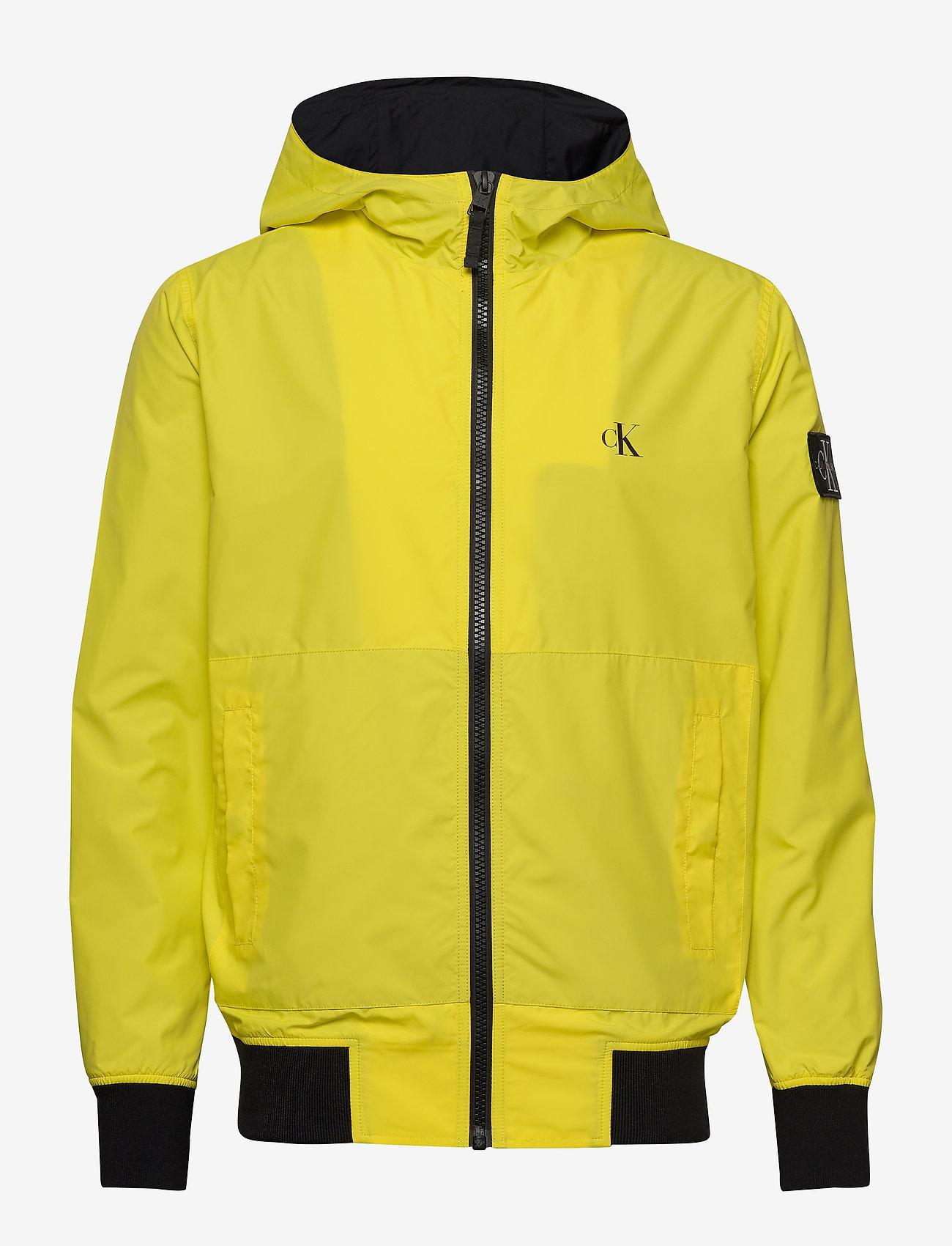 Calvin Klein Jeans - HOODED BLOCKING NYLON JACKET - light jackets - solar yellow/black - 1