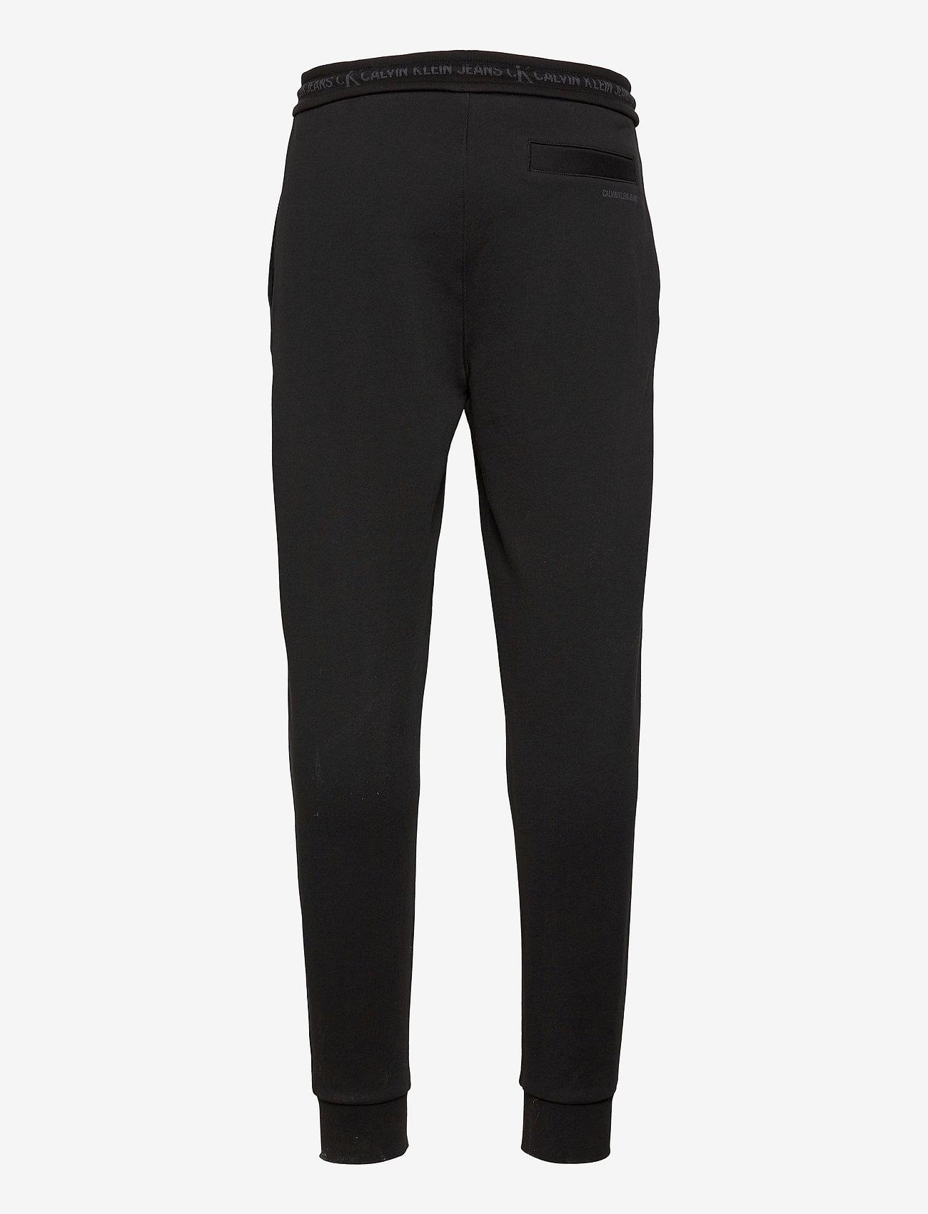 Calvin Klein Jeans - LOGO JACQUARD HWK PANT - kleding - ck black - 0