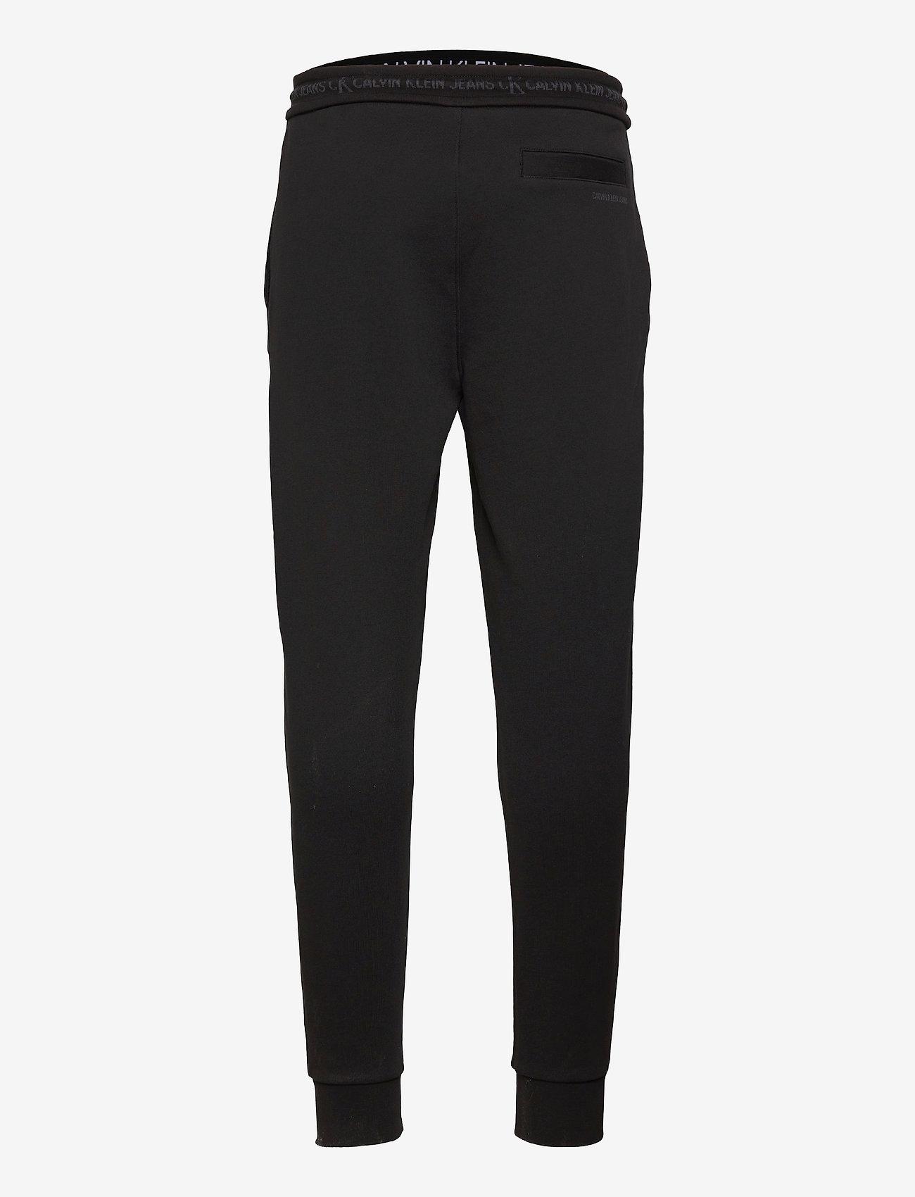 Calvin Klein Jeans - LOGO JACQUARD HWK PANT - kleding - ck black - 1