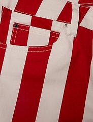 Calvin Klein Jeans - MID RISE SKINNY STRIPE PANT - broeken med skinny fit - racing red/bright white - 2