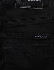 Calvin Klein Jeans - HIGH RISE SUPER SKINNY ANKLE - skinny jeans - da091 clean black shank - 4