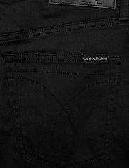 Calvin Klein Jeans - CKJ 058 SLIM TAPER - slim jeans - ca004 black - 4