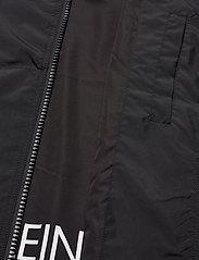 Calvin Klein Jeans - HOODED BLOCKING NYLON JACKET - light jackets - ck black/white - 6
