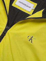 Calvin Klein Jeans - HOODED BLOCKING NYLON JACKET - light jackets - solar yellow/black - 5