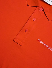 Calvin Klein Jeans - STRETCH INSTITUTIONAL POLO SLIM - polos à manches courtes - fiery red - 2