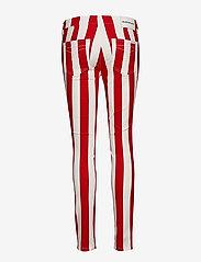 Calvin Klein Jeans - MID RISE SKINNY STRIPE PANT - broeken med skinny fit - racing red/bright white - 1