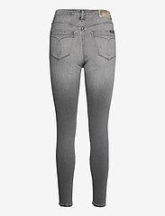Calvin Klein Jeans - HIGH RISE SUPER SKINNY ANKLE - skinny jeans - denim black - 1