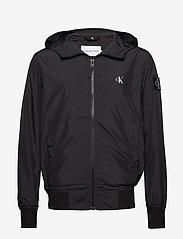 Calvin Klein Jeans - HOODED BLOCKING NYLON JACKET - light jackets - ck black/white - 0
