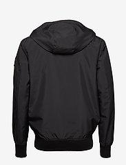 Calvin Klein Jeans - HOODED BLOCKING NYLON JACKET - light jackets - ck black/white - 2