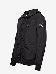 Calvin Klein Jeans - HOODED BLOCKING NYLON JACKET - light jackets - ck black/white - 3
