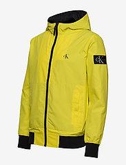 Calvin Klein Jeans - HOODED BLOCKING NYLON JACKET - light jackets - solar yellow/black - 3