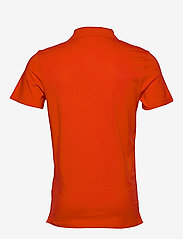 Calvin Klein Jeans - STRETCH INSTITUTIONAL POLO SLIM - polos à manches courtes - fiery red - 1