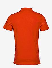 Calvin Klein Jeans - STRETCH INSTITUTIONAL POLO SLIM - korte mouwen - fiery red - 1
