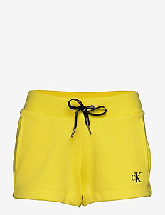 CK EMBROIDERY REGULA - casual shorts - solar yellow
