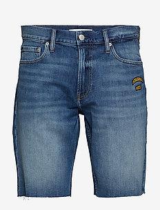 SLIM SHORT - short en jean - berger blue western badges rol