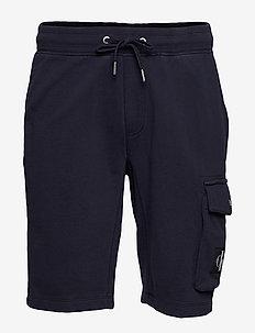 MONOGRAM BADGE HWK SHORT - casual shorts - night sky