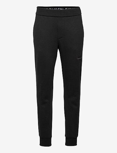 OFF PLACED ICONIC  HWK PANT - kläder - ck black